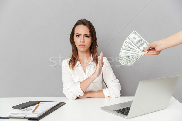 Portrait of a serious young business woman Stock photo © deandrobot