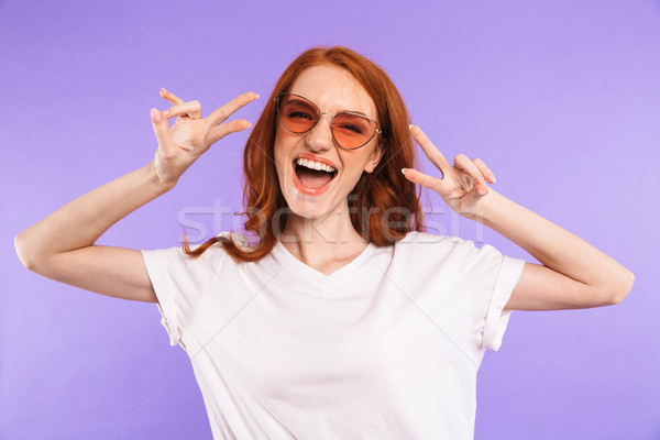 Portrait of a smiling young girl in sunglasses Stock photo © deandrobot