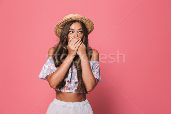 Portrait of silent serious woman 20s wearing straw hat looking a Stock photo © deandrobot
