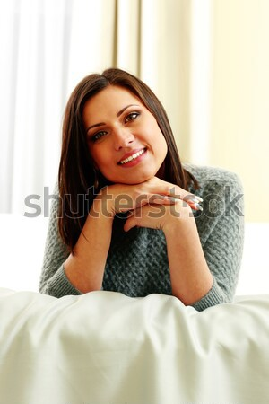 Middle-aged smiling woman looking at camera Stock photo © deandrobot
