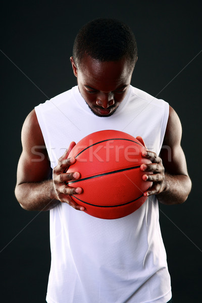 Portrait of a black man with backetball ball Stock photo © deandrobot