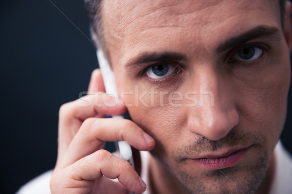 Handsome businessman talking on the phone Stock photo © deandrobot