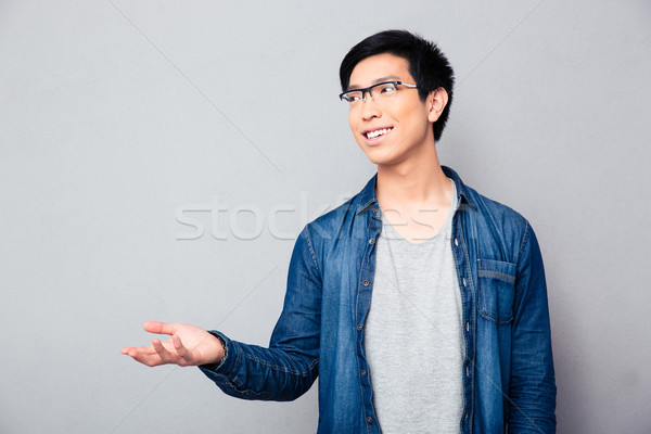 Man telling something and gesturing with hand Stock photo © deandrobot