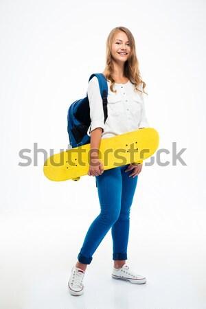 женщины студент скейтборде портрет Сток-фото © deandrobot