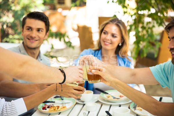 счастливым друзей тоста вокруг таблице Сток-фото © deandrobot
