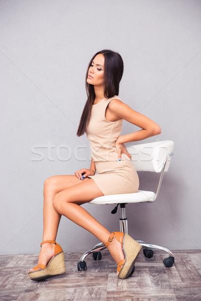 женщину сидят офисные кресла портрет элегантный компьютер Сток-фото © deandrobot