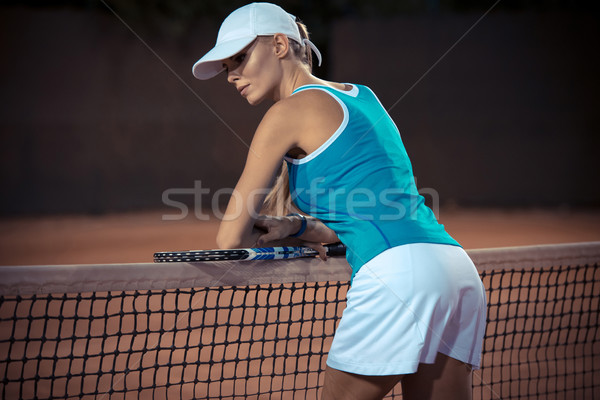 Woman resting after match at tennis court Stock photo © deandrobot