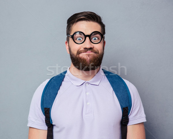 Portrait of a male nerd with funny face  Stock photo © deandrobot
