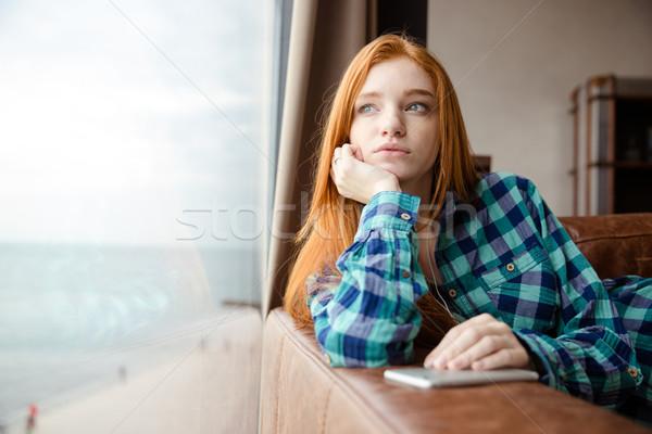 álmodik lány néz ki ablak zenét hallgat Stock fotó © deandrobot