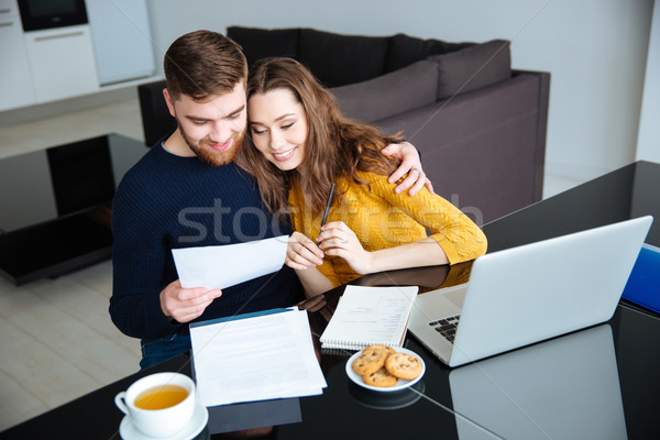 Couple managing their bills at home Stock photo © deandrobot
