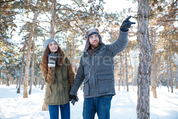 Handsome man walking with his girlfriend in winter park Stock photo © deandrobot