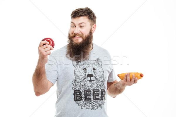красивый мужчина борода яблоко Hot Dog Сток-фото © deandrobot