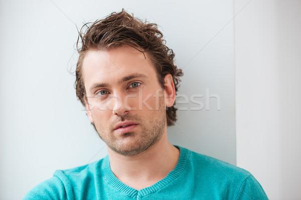 Sério atraente moço cabelos cacheados branco Foto stock © deandrobot