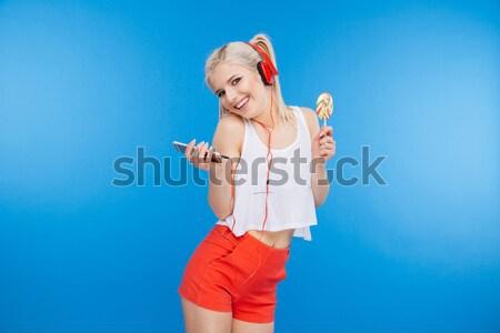 Charmant blonde vrouw lolly Blauw vrouw Stockfoto © deandrobot