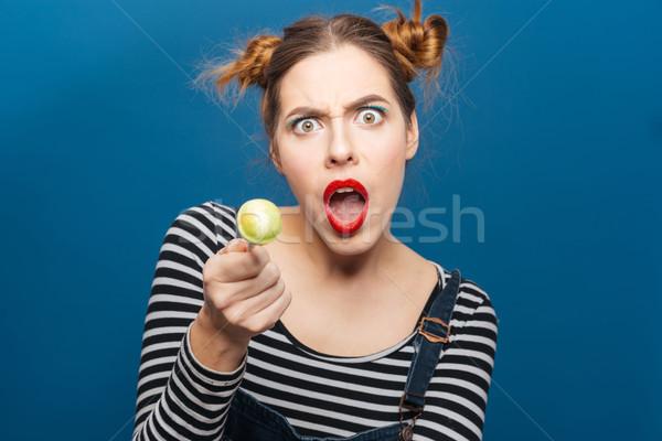 Zangado maravilhado mulher jovem pirulito Foto stock © deandrobot