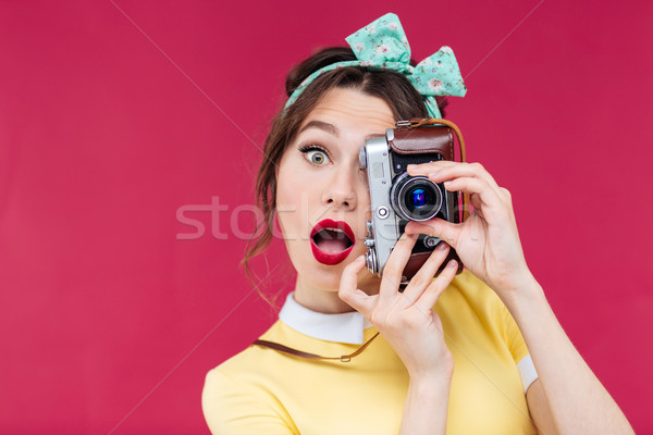 Surprised pretty pinup girl with mouth opened using vintage came Stock photo © deandrobot