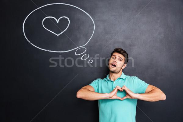 Férfi áll iskolatábla szív rajzolt szövegbuborék Stock fotó © deandrobot