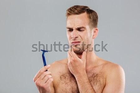 Stok fotoğraf: Genç · dalgın · adam · fırçalamak · gri