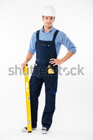 Smiling attrative young builder in overall with drill Stock photo © deandrobot
