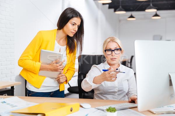 Businesswomen having a brainstorm meeting in the office Stock photo © deandrobot