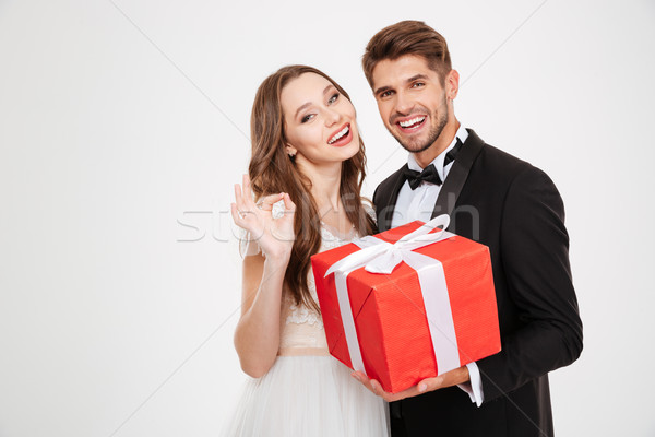 Happy newlyweds with gift Stock photo © deandrobot