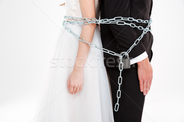 Close up portrait of couple with chaine Stock photo © deandrobot