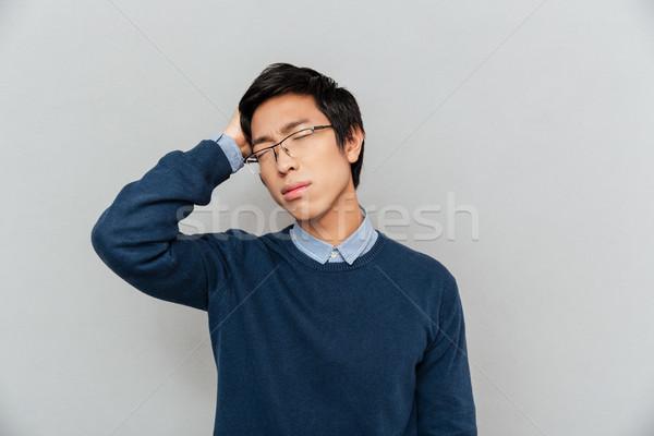 Stanco asian uomo lavoro capelli Foto d'archivio © deandrobot