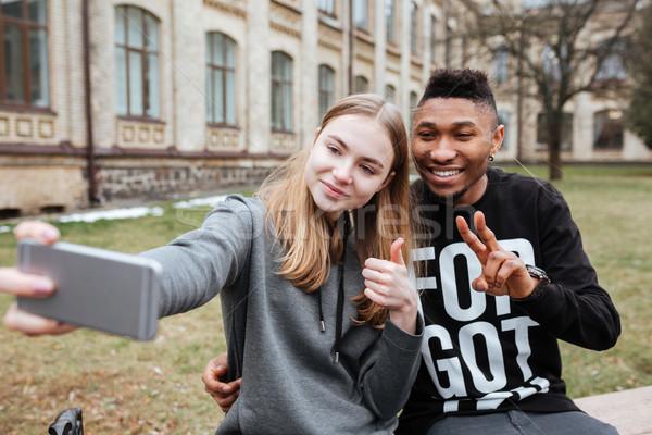 Jonge tieners paar buitenshuis stad Stockfoto © deandrobot
