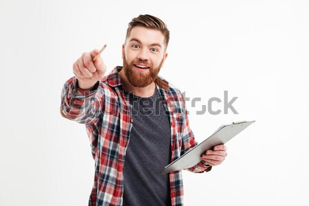 Excited bearded man in checkered shirt pointing pencil at camera Stock photo © deandrobot