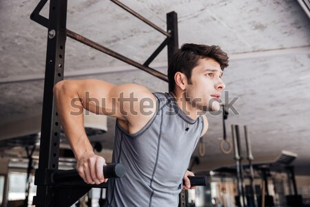 Model doing exercises in the gym Stock photo © deandrobot