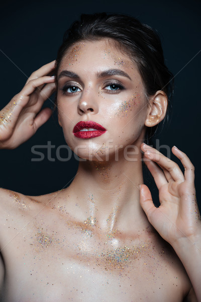Portrait of beautiful young woman with glitter makeup Stock photo © deandrobot