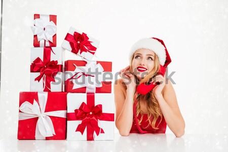 Frau Kostüm Sitzung halten vorliegenden Stock foto © deandrobot