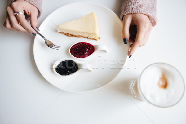 Top view picture of young woman in cafe having breakfast Stock photo © deandrobot