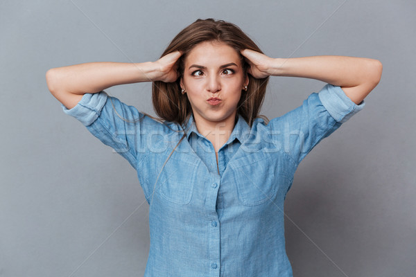 Funny Woman in shirt holding her hair Stock photo © deandrobot
