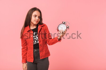 Fiatal zaklatott nő göndör haj tart ébresztőóra Stock fotó © deandrobot