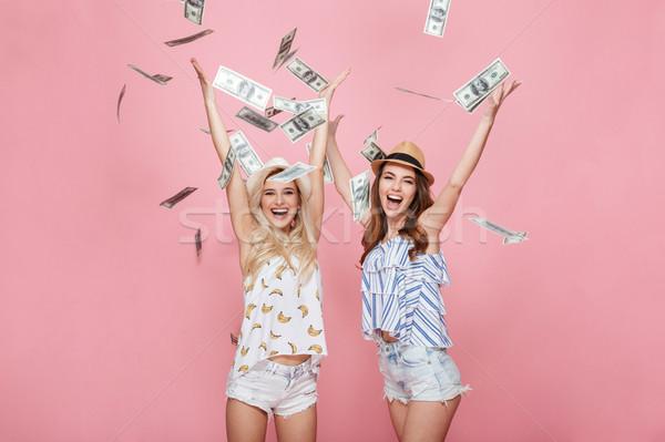 érzelmes nők áll pénz rózsaszín kép Stock fotó © deandrobot