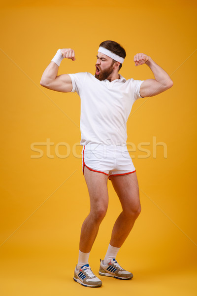 Vertical image sérieux biceps Photo stock © deandrobot