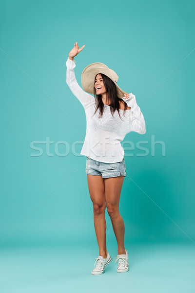 Vertical image of Happy woman in beachwear Stock photo © deandrobot