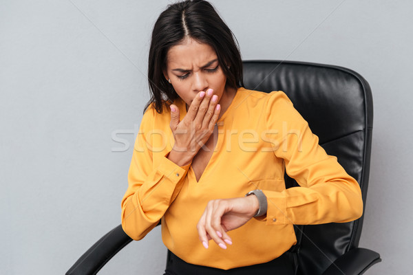 Portrait of a exhausted business woman yawning Stock photo © deandrobot