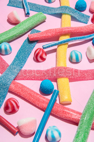 Mix of different types of colorful candies jellies Stock photo © deandrobot