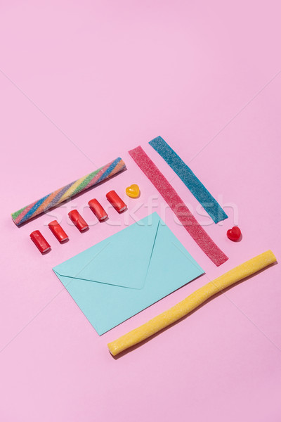 Blank envelope and colorful jelly candies in a row Stock photo © deandrobot
