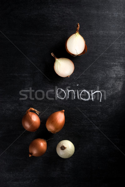 Top view photo of onion over dark chalkboard background Stock photo © deandrobot