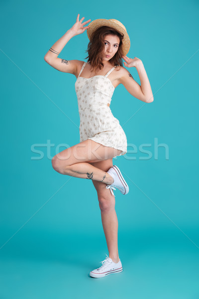 Full length portrait of a happy cheerful woman wearing hat Stock photo © deandrobot
