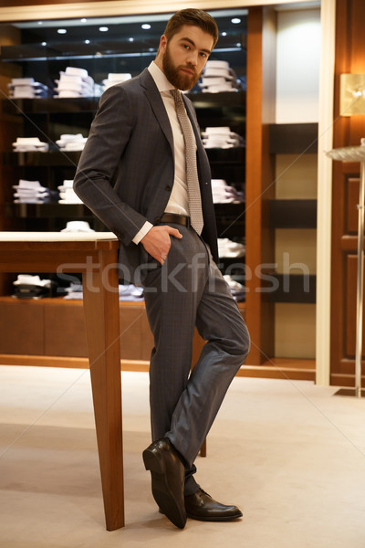 Vertical image of man posing in shop Stock photo © deandrobot