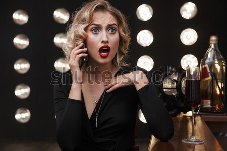 Happy woman wit red lips giving you glass of champagne Stock photo © deandrobot