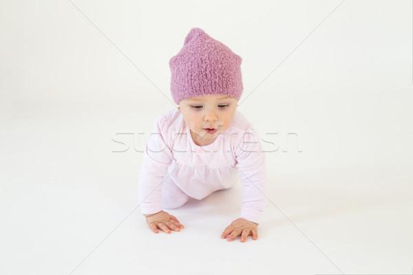 Little baby girl wearing hat sitting on floor Stock photo © deandrobot