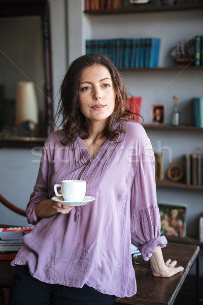 Portrait of a relaxed mature woman holding cup of coffee Stock photo © deandrobot