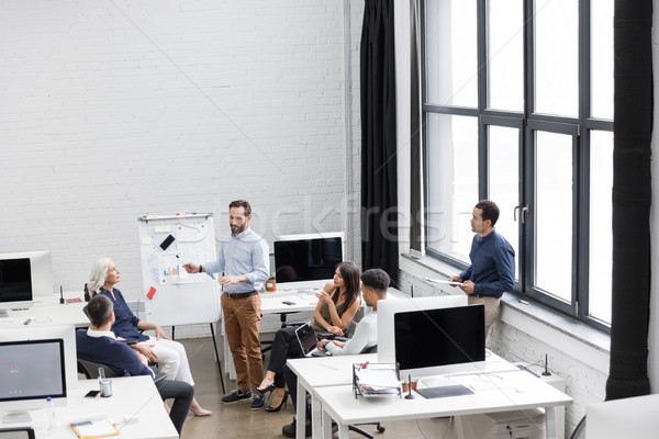 Group of professionals working on new business project Stock photo © deandrobot