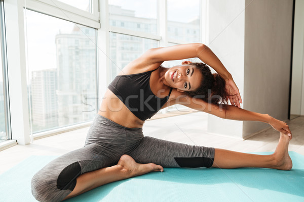 Healthy woman making difficult exercise on floor Stock photo © deandrobot