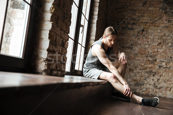 Retrato fitness homem sofrimento em dor Foto stock © deandrobot